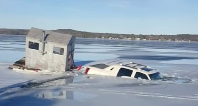 truck towing ice house falls through ice
